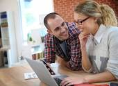 People at home websurfing on laptop — Stock Photo