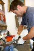 Man working in bicycle workshop — Stock Photo