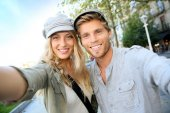 Trendy couple taking self-portrait picture — Stock Photo