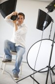 Photographer with lighting equipment — Stock Photo