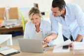 Business people working on laptop — Stock Photo