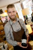 Man working in wine shop — Stock Photo