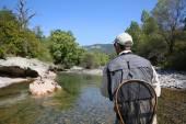 Fly fisherman flyfishing in river — Stock Photo