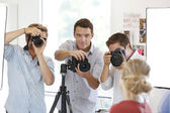 Photographers in studio with model — Stock Photo