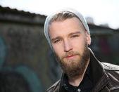 Stylish guy with beard in street — 图库照片