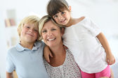 Happy mother with kids — Stock Photo