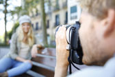 Photographer photographing fashion model — Stock Photo