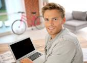 Student at home working on laptop — Stock Photo