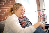 Roommates at home websurfing on laptop — Stock Photo