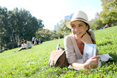 Woman reading New York city guide — Stock Photo