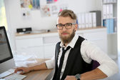 Man with beard and eyeglasses in office — Stock Photo