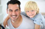 Father carrying son on back — Stock Photo