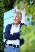 Man leaning on wall outside the house — Stock Photo