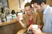 Couple websurfing on tablet — Stock Photo