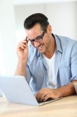 Man working at home with laptop — Stock Photo