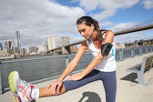 Woman stretching out on Brooklyn Heights promenade — Stock Photo