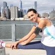 Woman stretching out on Brooklyn Heights promenade — Stock Photo #58090003