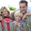 Family leaning on fence — Stock Photo #58090183