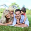 Family laying on grass — Stock Photo #58090257