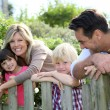 Family leaning on fence — Stock Photo #58090699