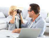 Little boy taking picture of daddy — Stock Photo