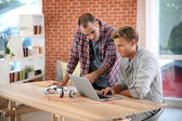 Men studying in front of laptop — Stock Photo