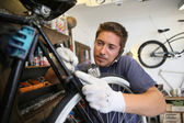 Man working in bike workshop — Stock Photo