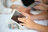 Hands holding digital tablet — Stock Photo