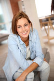 Young woman relaxing at home — Stock Photo