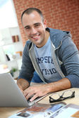Man at home websurfing on net — Stock Photo