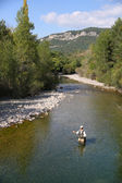 Fisherman fly-fishing in river — Stock Photo