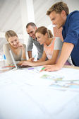 Young people studying architecture — Stock Photo