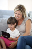 Mother and daughter playing game — Stock Photo