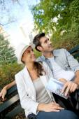 Tourists relaxing on bench in Central Park — Stock Photo