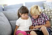 Kids playing with tablet — Stock Photo