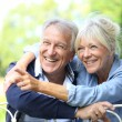 Senior couple enjoying day outside — Stock Photo #58901091