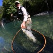 Fisherman catching fario trout in river — Stock Photo #58903649