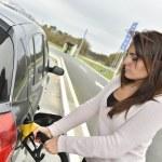 Woman filling car tank — Stock Photo #64673053