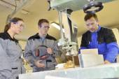 Students with woodwork machine — Stock Photo