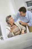 Home carer supporting elderly woman — Stock Photo