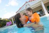 Mother and daughter in pool — Stock Photo