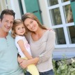 Family standing in front of house — Stock Photo #64685043