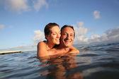 Couple swimming in sea — Stock Photo