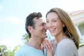 Couple standing in front of home — Stock Photo