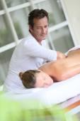Masseur doing massage to woman — Stock Photo