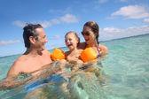 Family enjoying bathing — Stock Photo