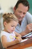 Daddy watching girl drawing — Stock Photo