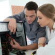 Teacher with student repairing computer — Stock Photo #67893437