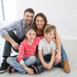 Family sitting on floor — Stock Photo #67893901