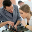 Teacher with student repairing computer — Stock Photo #67893997